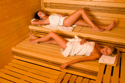 Sauna Two Healthy Beautiful Women Relaxing Lying Wrapped In Towel SYbMrnp4o W400 H400